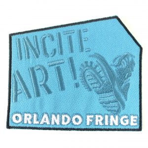 Blue Patch with Incite Art Orlando Fringe and a book stencil image.
